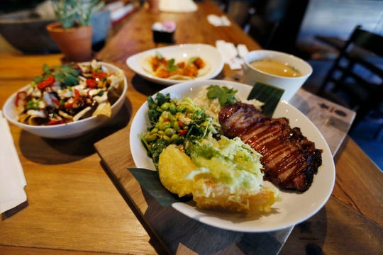 Some of the food at Nomi is shown Friday, Jan. 31, at the new restaurant on the West Side. Owner Fiean Liem also owns and operates two Koze restaurants and the Greenery in Sunland Park Mall.