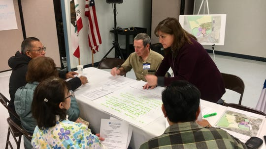Participants at a Wednesday night town hall meeting make a list regarding health care needs in the Santa Clara Valley.