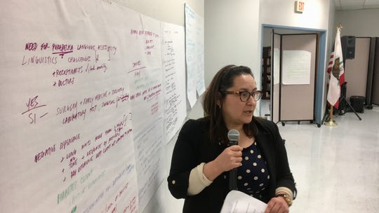 Small groups of residents discussed Santa Clara Valley health care needs in a town hall meeting Wednesday night in Fillmore. Here, Cynthia Salas presents one group's findings.