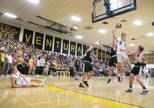 After missing a shot, Ventura High's Nate Johnston watches from the floor as his teammate Liam Cameron grabs the rebound during the third quarter of Wednesday night's rivalry game against Buena. Ventura won the regular-season finale, 61-51, to clinch second place in the Pacific View League.