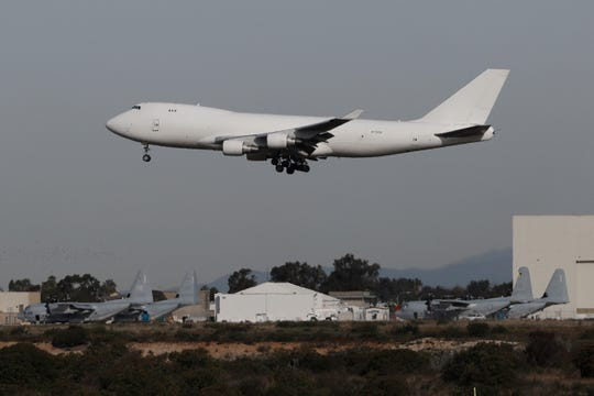 A plane carrying evacuees from the virus zone in China lands at Marine Corps Air Station Miramar on Wednesday in San Diego. One of two jets carrying Americans fleeing the virus zone in China landed Wednesday morning at Miramar after first landing at an Air Force base in Northern California. Some will be quarantined at a hotel on the base for 14 days while others will be quarantined at a Southern California military base, officials said.