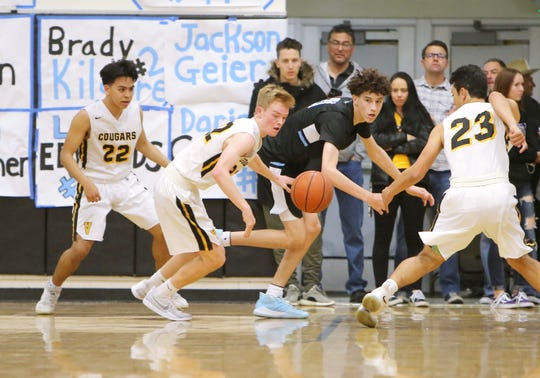 Brady Kilgore (middle) is the lone Buena High player as Ventura High's Fernando Ochoa (from left), Nate Johnston and Aidan Garza set their eyes on the rebound during the fourth quarter of Wednesday's game at Ventura High. Ventura won 61-52 to clinch second place in the Pacific View League.