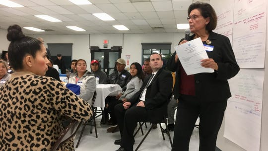 Bea Frias, right, a retired Santa Paula Hospital nurse manager, talks at a town hall meeting that explored the hospital's future.
