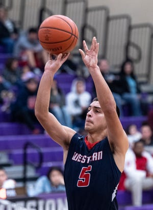 Tulare Western's Mikey Ficher shoots a free throw against Mission Oak in an East Yosemite League boys basketball game on Wednesday, February 5, 2020.