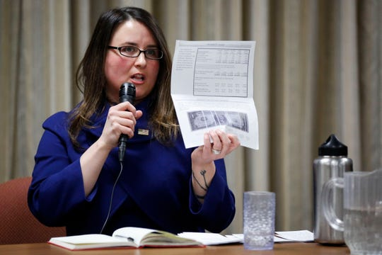 Wausau mayoral candidate Katie Rosenberg presents tax information while answering a question during a mayoral forum on Wednesday, February 5, 2020, at the University of Wisconsin Stevens Point satellite campus in Wausau, Wis.