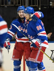 Feb 5, 2020; New York, New York, USA; New York Rangers center Mika Zibanejad (93) and right wing Pavel Buchnevich (89) celebrate after scoring during the second period against the Toronto Maple Leafs at Madison Square Garden. Mandatory Credit: Sarah Stier-USA TODAY Sports