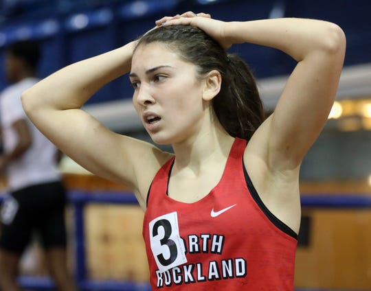 North Rockland's Haleigh Morales catches her breath after competing in the girls 1,000-meter tun during the Section 1 Class A Track & Field Championships at the Armory in Manhattan Feb. 5, 2020. Morales ran while sick and helped North Rockland win the girls Class A team title.