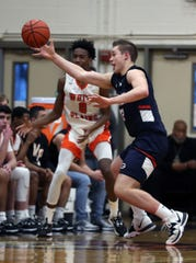 Horace Greeley's Nick Townsend (42) steals the ball away from White Plains' Quion Burns (0) during boys basketball action at White Plains High School Feb. 6, 2020. Greeley won the game 73-55.