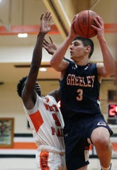 Horace Greeley's Chris Melis (3) goes up for a shot in front of White Plains' Mekhi Woodbury (5) during boys basketball action at White Plains High School Feb. 6, 2020. Greeley won the game 73-55.