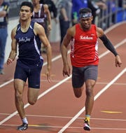 Jonathan Mahon of John Jay (East Fishkill) wins the Boys 300 Meter Dash with 35.06 over Roy C Ketcham's Davonte Burgos time of 35.09 during The Section 1 Class A track championships at the Armory in Manhattan Feb. 5, 2020.