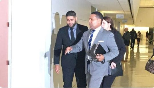 Juan Rodriguez of New City, left, returns to court in the Bronx on Thursday, Feb. 6, 2020. He faces charges in the July 2019 hot-car deaths of his 1-year-old twins.