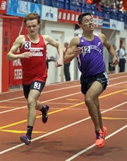 New Rochelle's Tristan Marine wins first place with the time of 4:24.50 over North Rockland's Bryan Onody in the Boys 1600 Meter Run during The Section 1 Class A track championships at the Armory in Manhattan Feb. 5, 2020.