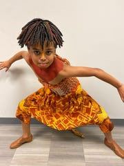 "Newark's Charlie Kahler, 10, poses as Young Simba, the character he plays in the touring version of the Broadway musical ""The Lion King""."
