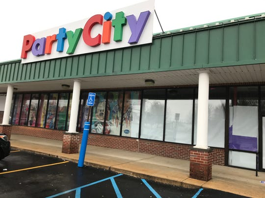 Windows are covered for Party City that closed in Elsmere.