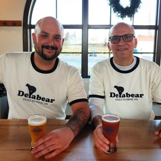 Customers wear Delabear Beer shirts at Wilmington Brew Works in December. The shirts sold out in less than a week. A new batch in a new color (baby blue) will be for sale next week.