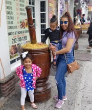 Ruth Reyes is shown with her children.