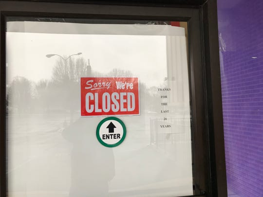 A sign on the front door to the Elsmere Party City store that closed after 26 years.