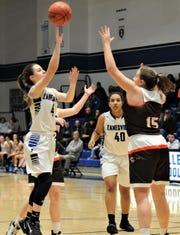 Zanesville's Emmah Kronenbitter takes a shot over Meadowbrook's Lynsey Dudley in Wednesday's game. Zanesville won 54-30.
