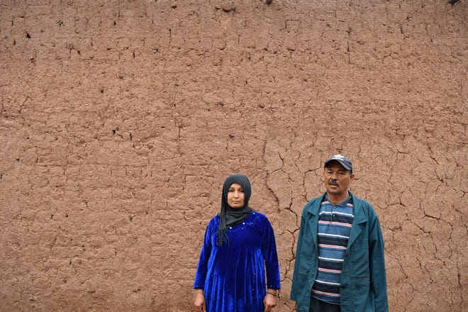 Hamid Lomani, right, is joined by his daughter on Nov. 22, 2019, in their home village of Si Abdikar, Morocco. Lomani's son Aziz was one of 45 who drowned Sept. 28, 2019, in an attempt to travel to Spain by crossing the Atlantic Ocean.