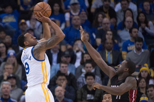 January 10, 2017; Oakland, CA, USA; Golden State Warriors forward Andre Iguodala (9) shoots the basketball against Miami Heat guard Dion Waiters (11) during the second quarter at Oracle Arena. The Warriors defeated the Heat 107-95. Mandatory Credit: Kyle Terada-USA TODAY Sports