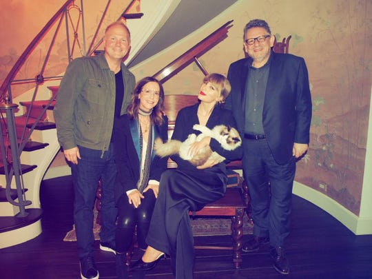 Taylor Swift (center, with her cat, Benjamin Button) sits with Troy Tomlinson, Jody Gerson and Sir Lucian Grainge at Universal Music Publishing Group.