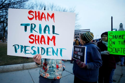 """In solidarity with protests nationwide, Berkshire residents gather at Park Square in Pittsfield, Massachusetts to """"Reject the Cover-up,"""" just minutes after the Senate voted to acquit President Trump."""