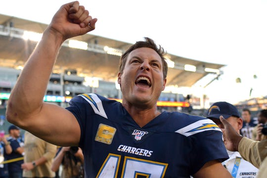 Los Angeles Chargers quarterback Philip Rivers (17) reacts after a 26-11 victory over the Green Bay Packers at Dignity Health Sports Park.
