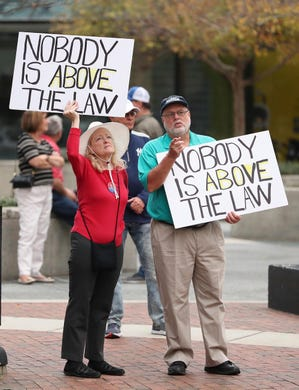 Protestors show their grievance with the acquittal of President Donald Trump's impeachment in Orlando, Florida.