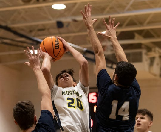 Marlboro Jay Ratner goes up with a first half shot. Middletown South Boys Basketball vs Marlboro in Marlboro, NJ on February 6, 2020.