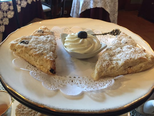 Blueberry scones and clotted cream during afternoon tea at Mathis House in Toms River.