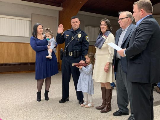 Lakehurst Police Chief Matthew J. Kline is sworn in Thursday night at a Borough Council meeting, with his family and borough officials at his side.