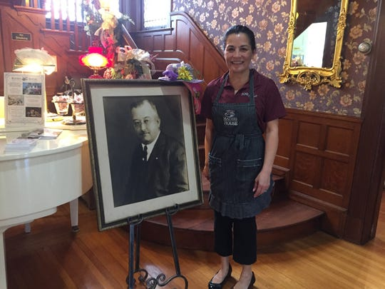 Vicki Weiss, owner of Mathis House, a B&B and tea room in Toms River, stands next to a portrait of Thomas Mathis, original owner of the home and a 19th-century New Jersey politician, innovator and businessman.
