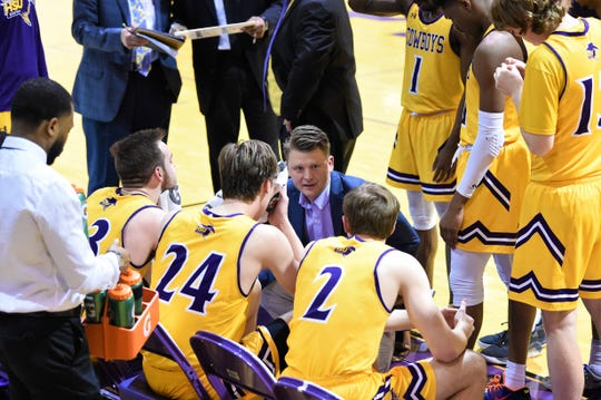 Hardin-Simmons coach Matt Brackett talks to his team during a timeout against Louisiana College at the Mabee Complex on Thursday. The Cowboys won 61-59 on a last-second shot for their third win in four games.