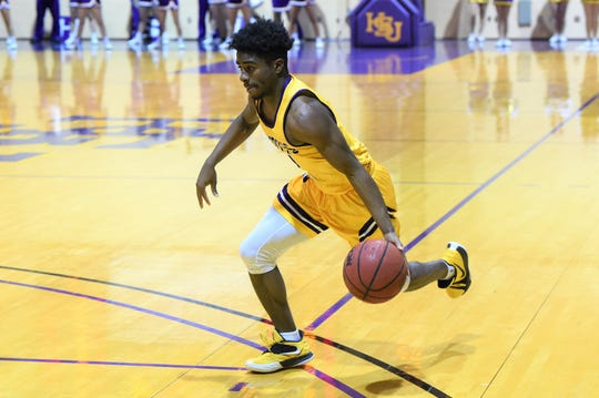 Hardin-Simmons guard Chris Barrett (1) drives towards the basket against Louisiana College at the Mabee Complex on Thursday. The Cowboys won 61-59 on Barrett's last-second shot for their third win in four games.