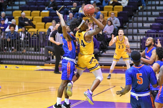 Hardin-Simmons' Steven Quinn (14) goes up for a shot against Louisiana College at the Mabee Complex on Thursday. The Cowboys won 61-59 on a last-second shot for their third win in four games.