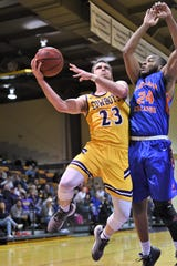 Hardin-Simmons' Chase Cobb (23) battles through contact to put up a shot against Louisiana College at the Mabee Complex on Thursday. The Cowboys won 61-59 on a last-second shot for their third win in four games.