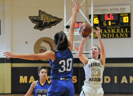 Haskell sophomore Delaney Hanson (23) takes a 3-pointer as Stamford's Citlaly Gutierrez closes in on Thursday, Feb. 6, 2020, at the Teepee in Haskell.