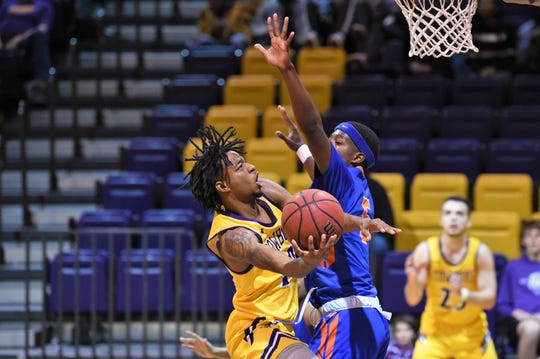 Hardin-Simmons' Kyle Brennon (10) tries to go around a Louisiana College defender for a shot at the Mabee Complex on Thursday. The Cowboys won 61-59 to pull into a three-way tie for third place in the American Southwest Conference West division.