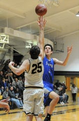 Stamford post Austin Brewer shoots over Haskell's Logan Burson on Feb. 6 at the Teepee in Haskell.