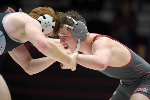 Avery County's Bradley Parker wrestles Robbinsville's Kameron McGuire in a 152-pound match during the 1A NCHSAA West Regional final at Avery County High School on Feb. 6, 2020.