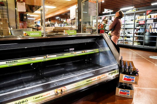 Shelves at Earth Fare were starting to go empty in West Asheville February 7, 2020.