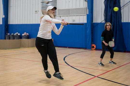 Jaynie Tank, left, and Sue McPherson play pickleball at a gym in Hendersonville. Asheville Parks and Recreation is considering a dedicated pickleball court in Recreation Park to accommodate the growing number of local players.