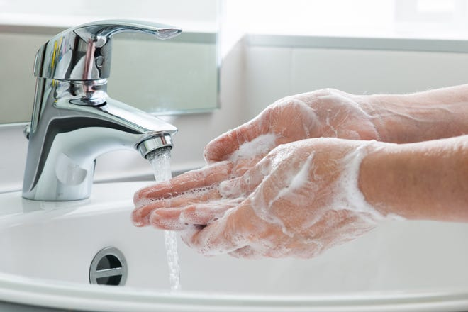Wash your hands, vigorously, with soap and water for at least 20 seconds