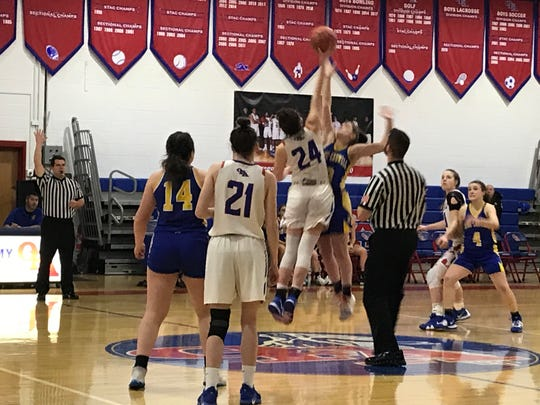 Owego's Evee Coleman and Maine-Endwell Sophia Pelton go after the opening tip in Thursday's Southern Tier Athletic Conference game at Owego. The Indians won, 60-52.
