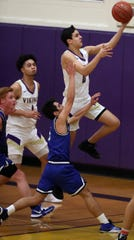 North Kitsap's Johny Olmsted goes up for a layup ahead of North Mason's Reid Williams on Thursday, Feb. 6, 2020.