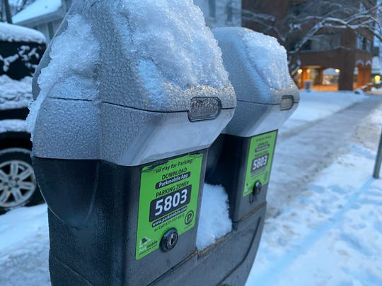 Parking meters covered in ice during ice and snow storm Feb. 7, 2020. A parking ban in Burlington was in effect at the time.
