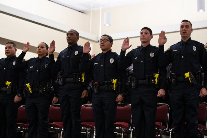 The Corpus Christi police academy's 78th class take the other of office at the end of their graduation on Friday, Feb. 7, 2020.