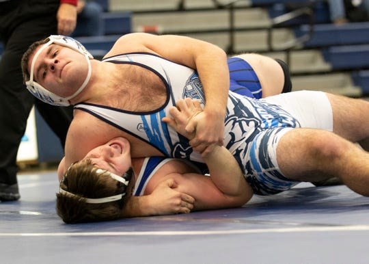 Adena senior Dalton Metzger pinned Southeastern's Landon Coonrod in a 170-pound match during a tri match at Adena High School in Frankfort, Ohio, on Feb. 06, 2020.
