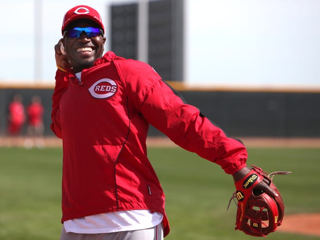 Brandon Phillips is all smiles as he tosses a ball around during spring training on Friday, Feb. 26, 2010 in Goodyear, Ariz.