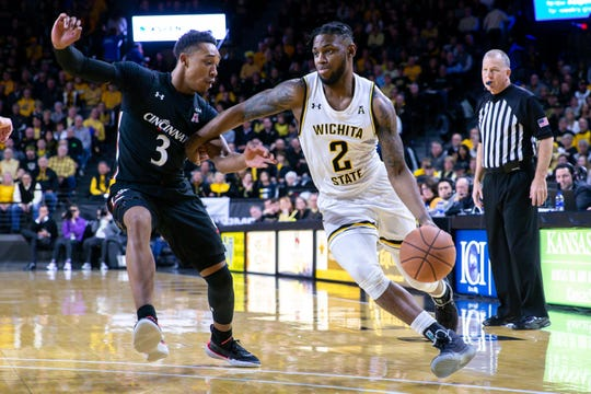 Feb 6, 2020; Wichita, Kansas, USA; Wichita State Shockers guard Jamarius Burton (2) drives to the basket during the first half against the Cincinnati Bearcats at Charles Koch Arena.